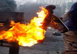 عشرات الإخوان يشعلون النيران في نقطة مرور بشارع فيصل بالجيزة