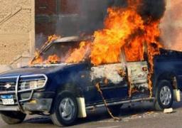 مجهولون يشعلون النيران فى سيارتى شرطة أمام قسم مينا البصل